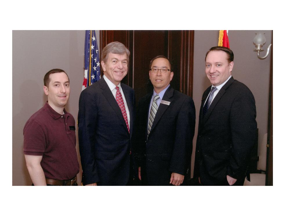 Dr. Evan Schwarz, Senator Roy Blunt, Dr. Douglas Char, and Dr. Robert Poirier